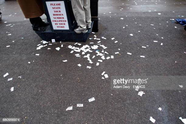 Torn up losing tickets surround a bookies stall