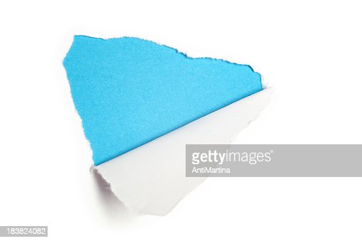Torn white paper revealing light blue background