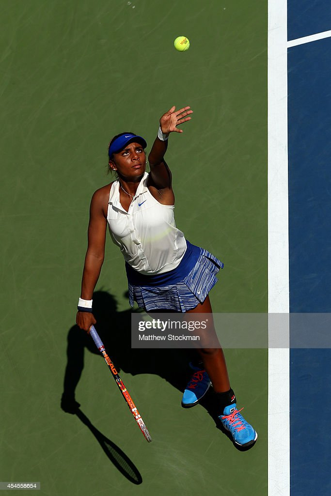 Tornado Alicia Black of the United States serves against Viktoria Kuzmova of Slovakia during their junior girls' second round match on Day Ten of the 2014 US Open at the USTA Billie Jean King National Tennis Center on September 3, 2014 in the Flushing neighborhood of the Queens borough of New York City.
