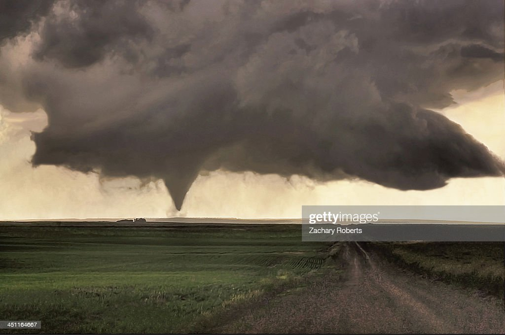 CONTENT] A tornado churns along the countryside of Saskatchewan Canada.