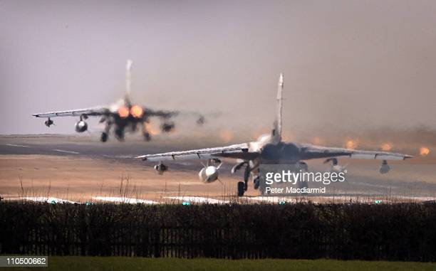 Tornado GR4 aircraft takes off as another waits on the runway at Royal Air Force Marham on March 21 2011 in Marham England The Pentagon says that...