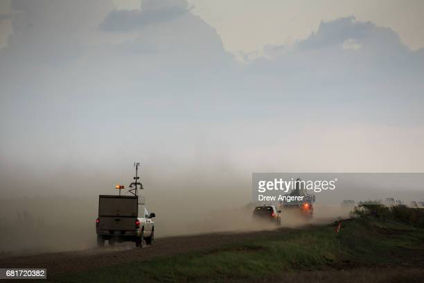 A tornado scout vehicle and the Doppler on Wheels vehicle chase after a supercell thunderstorm during a tornado research mission May 10 2017 in...