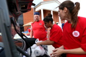 Tornado victim Johnathan Boyd collects assistance items from Salvation Army volunteers on May 25 2013 in Moore Oklahoma The tornado of EF5 strength...