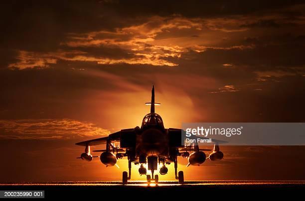 Tornado war plane, silhouette, sunset