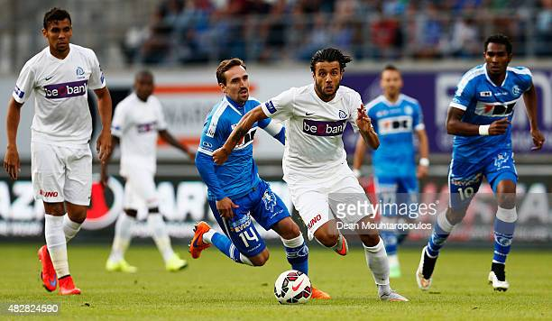 Tornike Okriashvili of Genk runs with the ball past Sven Kums of Gent during the Jupiler League match between KAA Gent and KRC Genk held at the...