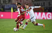 Tornike Okriashvili of Georgia and Bastian Schweinsteiger of Germany compete for the ball during the EURO 2016 Group D Qualifier match between...