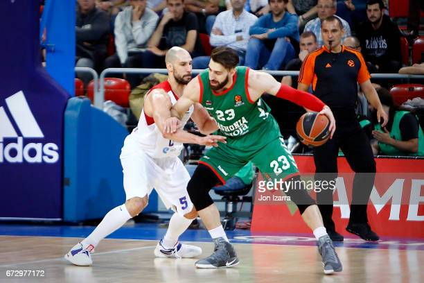 Tornike Shengelia #23 of Baskonia Vitoria Gasteiz competes with James Augustine #5 of CSKA Moscow during the 2016/2017 Turkish Airlines EuroLeague...