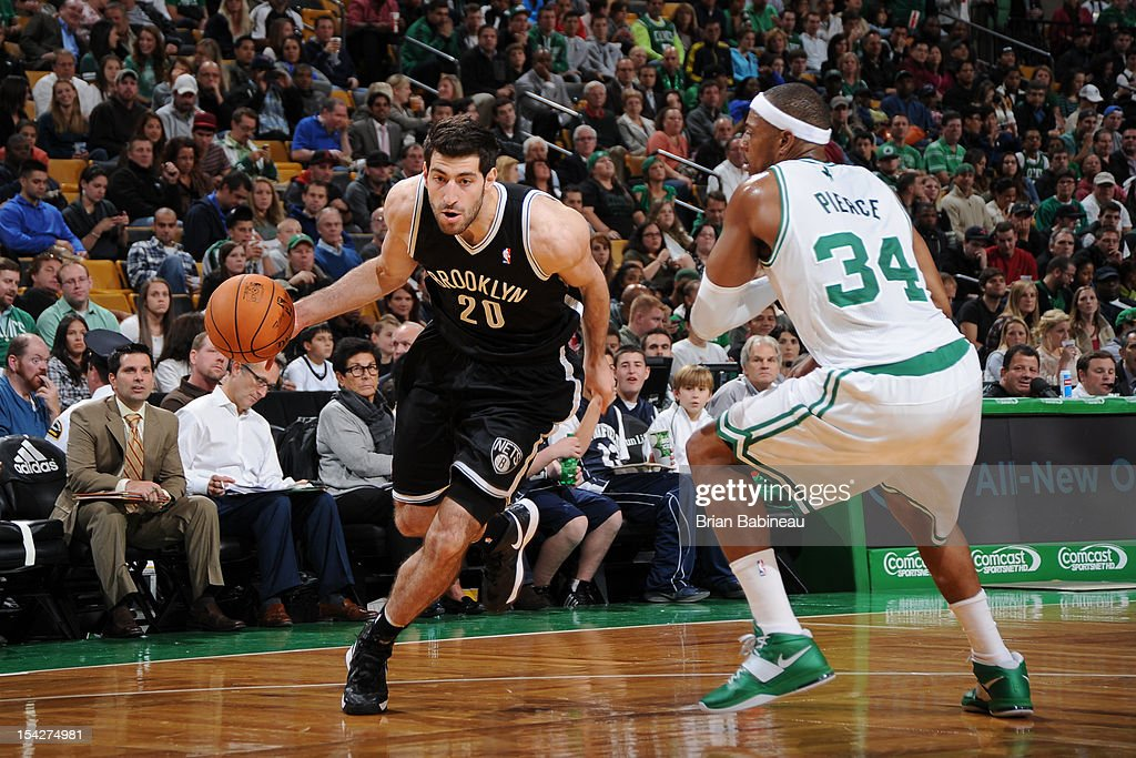 Tornike Shengelia #20 of the Brooklyn Nets handles the ball against <a gi-track='captionPersonalityLinkClicked' href=/galleries/search?phrase=Paul+Pierce&family=editorial&specificpeople=201562 ng-click='$event.stopPropagation()'>Paul Pierce</a> #34 of the Boston Celtics on October 16, 2012 at the TD Garden in Boston, Massachusetts.