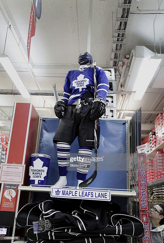 Tornoto Maple Leaf hockey gear is displayed on a mannequin for sale at a Canadian Tire Corp. store in Toronto, Ontario, Canada, on Friday, Jan. 18, 2013. STCA - Statistics Canada is scheduled to release retail sales data on Jan. 21. Photographer: Reynard Li/Bloomberg via Getty Images