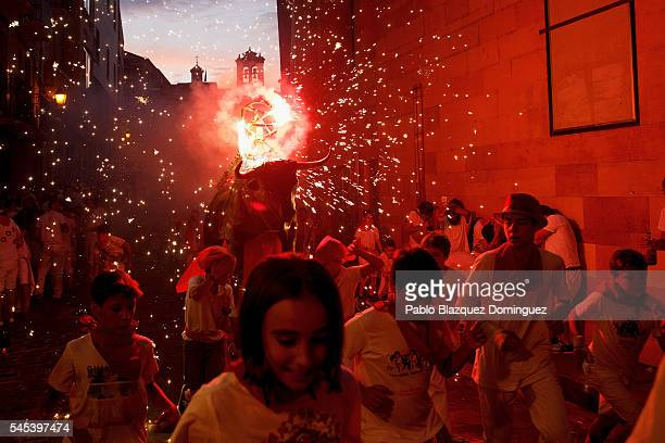 Toro del Fuego is run through the streets of Pamplona during the second day of the San Fermin Running of the Bulls festival on July 7 2016 in...