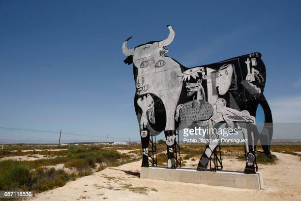 Toro Osborne sign stands painted featuring 'El Guernica' painting on May 22 2017 near Santa Pola in Alicante province Spain An Osborne bull appeared...