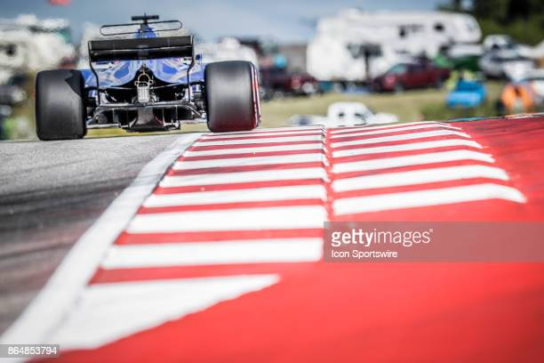 Toro Rosso driver Daniil Kvyat of Russia drives through turn 9 during qualifying for the Formula 1 United States Grand Prix on October 21 at the...