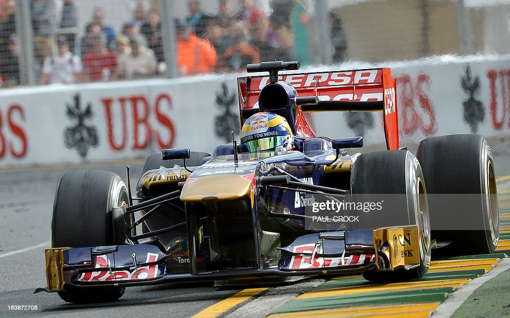 Toro Rosso driver Jean-Eric Vergne of France powers out of a corner during the Formula One Australian Grand Prix in Melbourne on March 17, 2013. IMAGE RESTRICTED TO EDITORIAL USE - STRICTLY NO COMMERCIAL USE AFP PHOTO / Paul CROCK