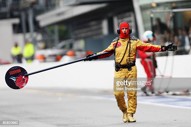 Toro Rosso lollipop man signals to one of their cars to come in for a pitstop during the Italian Formula One Grand Prix at the Autodromo Nazionale di...