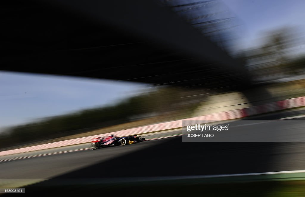 Toro Rosso's Australian driver Daniel Ricciardo drives during the Formula One test days at Catalunya's racetrack in Montmelo, near Barcelona, on March 3, 2013. . AFP PHOTO/JOSEP LAGO