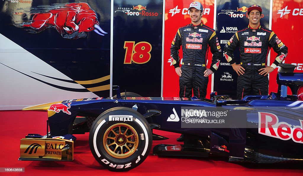 Toro Rosso's drivers, Australian Daniel Ricciardo (R) and French Jean-Eric Vergne pose with the new Formula One car STR8 on February 4, 2013 as part of a training session at the Jerez de la Frontera racetrack.