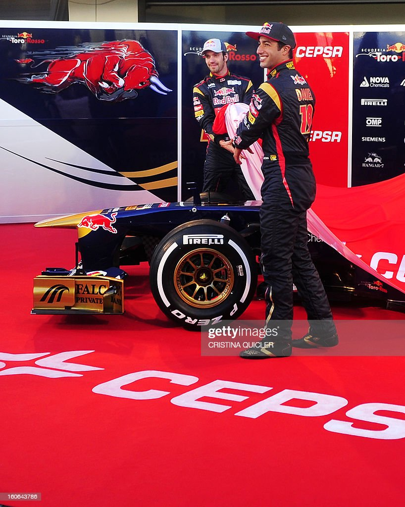 Toro Rosso's drivers, Australian Daniel Ricciardo (R) and French Jean-Eric Vergne unveil the new Formula One car STR8 on February 4, 2013 as part of a training session at the Jerez de la Frontera racetrack.
