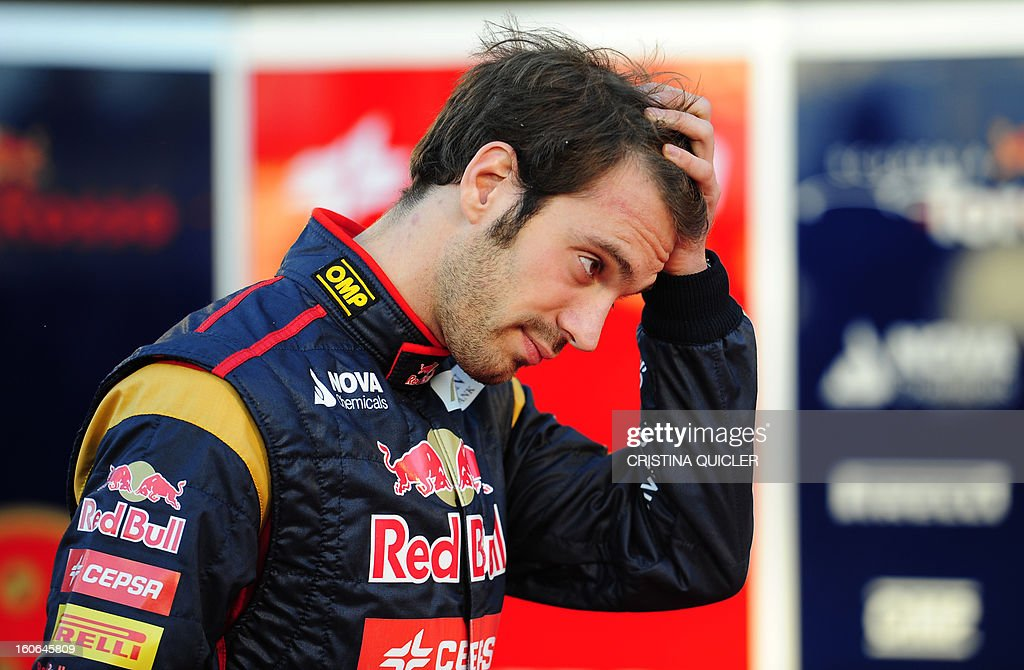 Toro Rosso's French driver Jean-Eric Vergne gestures during the unveil of the new Formula One car STR8 on February 4, 2013 as part of a training session at the Jerez de la Frontera racetrack. AFP PHOTO/ CRISTINA QUICLER
