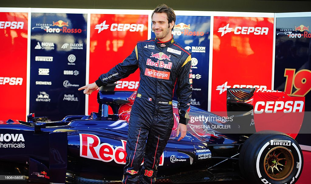 Toro Rosso's French driver Jean-Eric Vergne gestures during the unveil of the new Formula One car STR8 on February 4, 2013 as part of a training session at the Jerez de la Frontera racetrack.