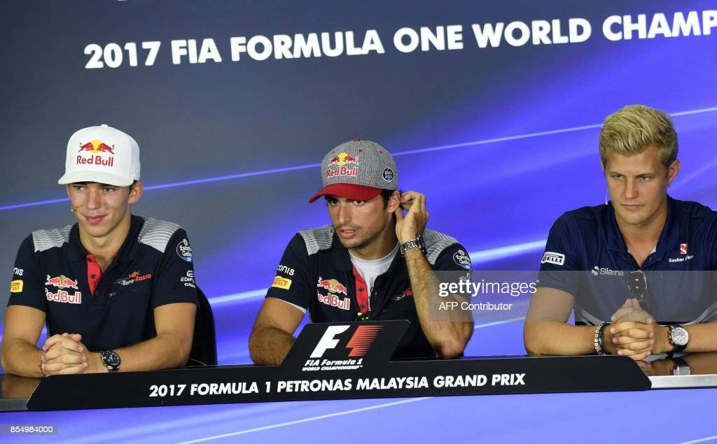 Toro Rosso's French driver Pierre Gasly (L) and Spanish driver Carlos Sainz Jr (C) with Sauber's Swedish driver Marcus Ericsson (R) attend a press conference ahead of the Formula One Malaysia Grand Prix at the Sepang circuit near Kuala Lumpur on September 28, 2017. /