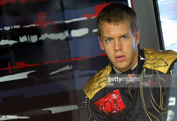 Toro Rosso's German driver Sebastien Vettel is pictured in the pits of the Hungaroring racetrack on August 1 2008 during the first practice session...