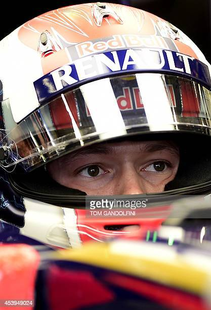 Toro Rosso's Russian driver Daniil Kvyat looks at a control screen in the pits during the first practice session at the SpaFrancorchamps circuit in...