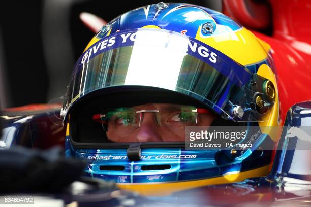 Toro Rosso's Sebastian Bourdais sits in his cockpit during practice at the Shanghai International Circuit China