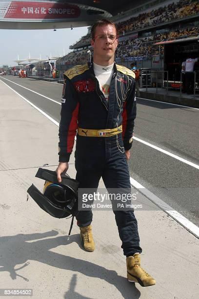 Toro Rosso's Sebastien Bourdais walks down the pit lane at the Shanghai International Circuit China