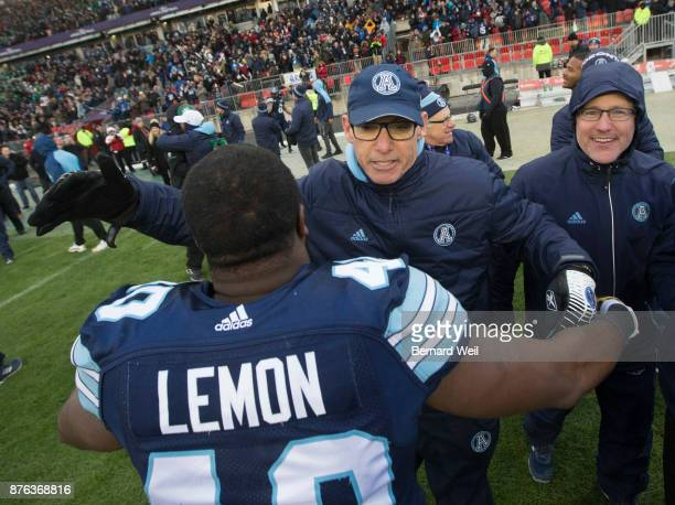 TORONTO ON NOVEMBER 19 Toronto Argo coach Marc Trestman hugs Toronto Argonauts defensive lineman Shawn Lemon after beating Saskatchewan Roughriders...