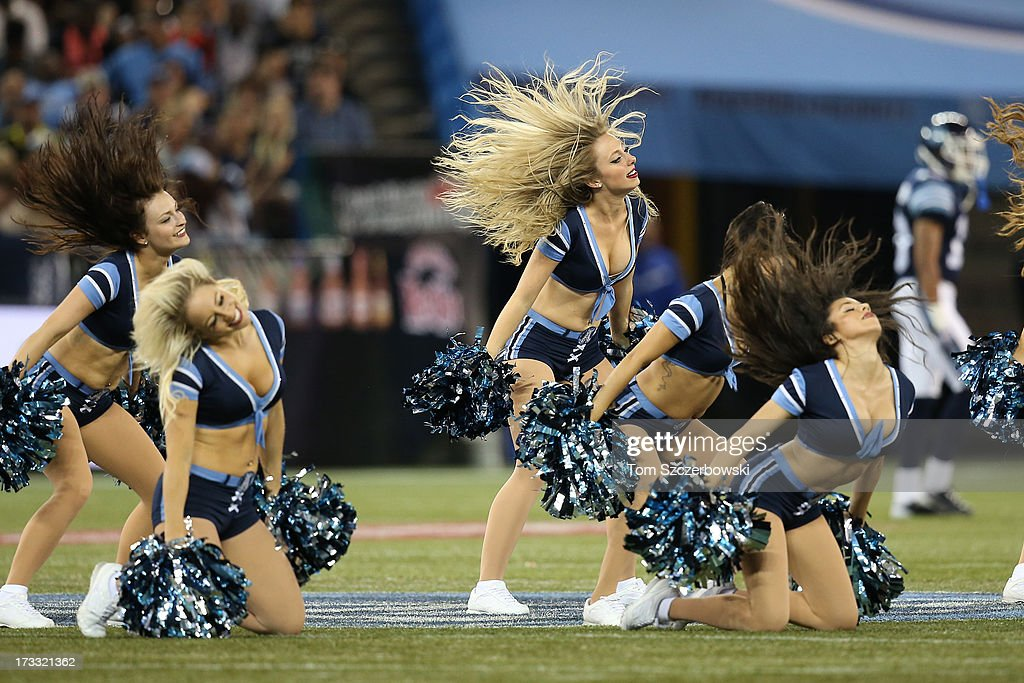 Toronto Argonauts cheerleaders perform during a CFL game against the Saskatchewan Roughriders on July 11, 2013 at Rogers Centre in Toronto, Ontario, Canada.