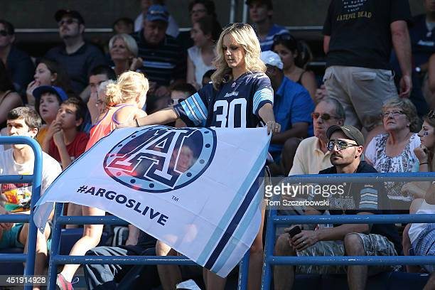 Toronto Argonauts fan unfurls a banner during CFL game action against the Saskatchewan Roughriders on July 5 2014 at Rogers Centre in Toronto Ontario...