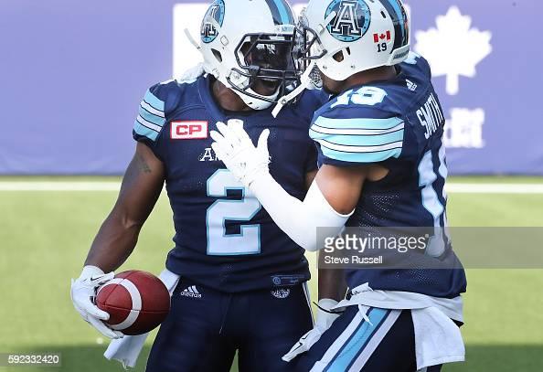 TORONTO ON AUGUST 20 Toronto Argonauts linebacker Keon Raymond celebrates after running an interception back as the Toronto Argonauts play the...