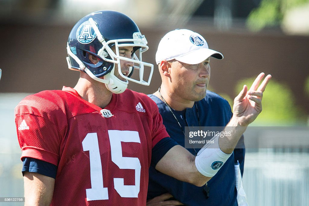 GUELPH, ON - MAY 31 - Toronto Argonauts quarterback Rickey Ray talks with coach Scott Milanovich during a practice at Guelph University. May 31, 2016.