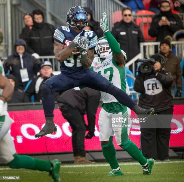 TORONTO ON NOVEMBER 19 Toronto Argonauts running back James Wilder Jr makes the catch over Saskatchewan Roughriders linebacker Samuel Eguavoen to set...