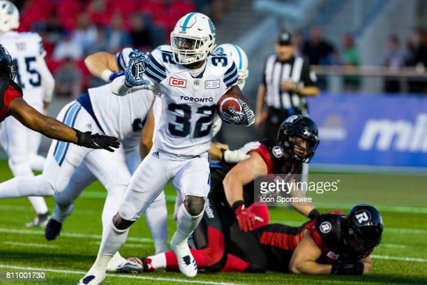 Toronto Argonauts running back James Wilder prepares to stiff arm a defender during Canadian Football League action between the Toronto Argonauts and...