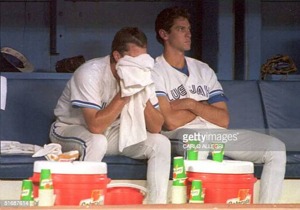 Toronto Blue Jay pitcher Pat Hentgen wipes his face with a towel after he got pulled from the game against the Boston Red Sox with teammate Shawn...
