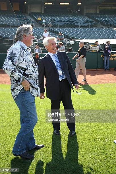 Toronto Blue Jays' broadcasters Buck Martinez and Jack Morris stand on the field prior to the game against the Oakland Athletics at Oco Coliseum on...