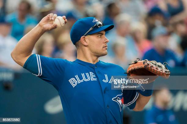 Toronto Blue Jays Catcher Luke Maile catches warmup pitches during a pitching change in the regular season MLB game between the New York Yankees and...
