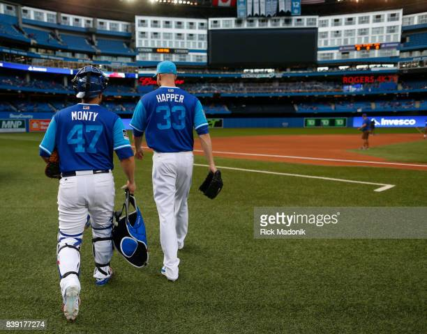 Toronto Blue Jays catcher Miguel Montero and Toronto Blue Jays starting pitcher JA Happ walk out for the warm up Toronto Blue Jays Vs Minnesota Twins...