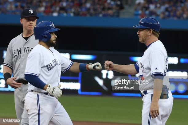 TORONTO ON AUGUST 9 Toronto Blue Jays catcher Raffy Lopez reaches base on a walk in his debut as the Toronto Blue Jays play the New York Yankees at...