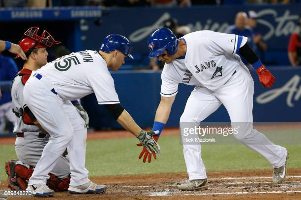 Toronto Blue Jays catcher Russell Martin greets Toronto Blue Jays shortstop Troy Tulowitzki at home plate after Tulo's massive Grand Slam Toronto...