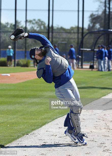 Toronto Blue Jays catcher Russell Martin makes a catch during a popup drill where the catcher starts with his back to a ball that is launched...