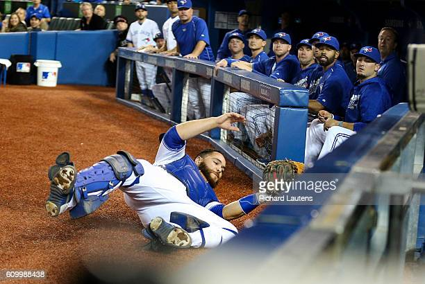 TORONTO ON SEPTEMBER 23 Toronto Blue Jays catcher Russell Martin slides almost into the dugout as he tries to chase down a foul ball by New York...