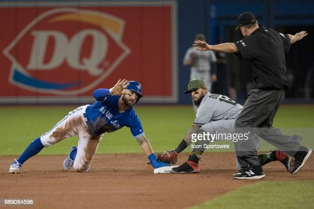 Toronto Blue Jays Center field Kevin Pillar motions to the second base umpire who confirms he is safe after Texas Rangers Second base Rougned Odor...