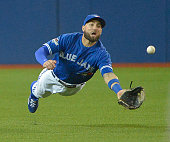 Toronto Blue Jays center fielder Kevin Pillar makes a diving catch to rob the Texas Rangers' Josh Hamilton of a base hit during the fourth inning...