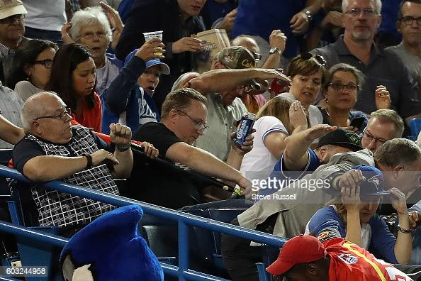 TORONTO ON SEPTEMBER 12 Toronto Blue Jays designated hitter Edwin Encarnacion loses his grip on his bat sending it into the third base stands as the...