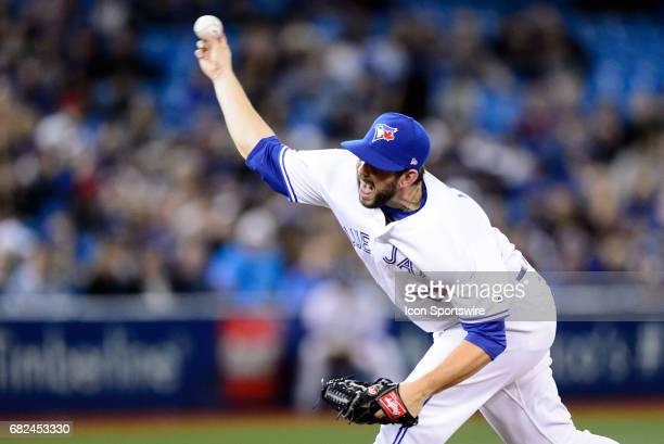Toronto Blue Jays Dominic Leone throws a pitch during the MLB regular season game between the Toronto Blue Jays and the Cleveland Indians on May 10...