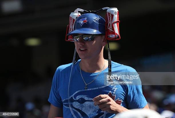 Toronto Blue Jays fan wears a beer helmet holding two cans of Budweiser beer during MLB game action against the Detroit Tigers on August 9 2014 at...