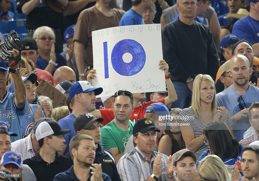Toronto Blue Jays fans anticipate the team winning its tenth consecutive game during MLB game action against the Baltimore Orioles on June 22, 2013 at Rogers Centre in Toronto, Ontario, Canada.