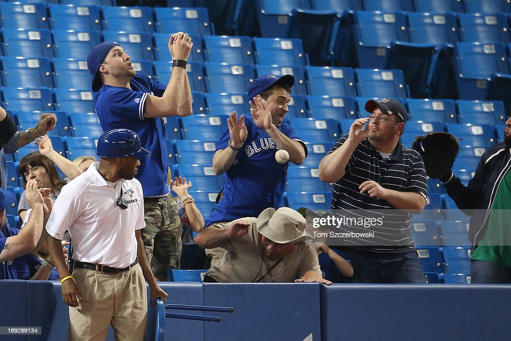 Toronto Blue Jays fans cannot catch a foul ball during MLB game action against the Tampa Bay Rays on May 22, 2013 at Rogers Centre in Toronto, Ontario, Canada.